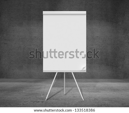 blank flip chart on tripod and concrete room - stock photo