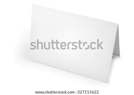 Blank folded card on plain background - stock photo