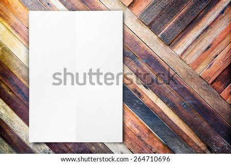 Blank folded paper poster hanging on diagonal wooden wall,Template mock up for adding your design. - stock photo