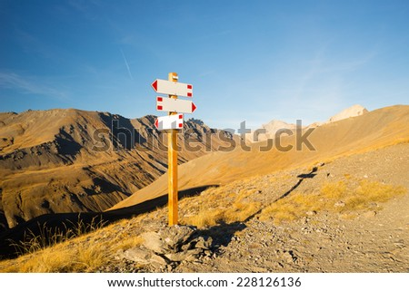 Blank footpath signposts leading to various direction. Copy space ready to be filled with text. Conceptual leading indicator. - stock photo