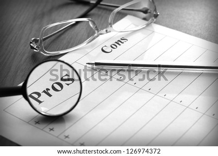 blank form for the pros and cons, black and white image - stock photo
