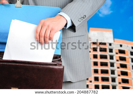 Blank form of the contract in male hands - stock photo