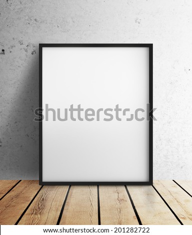blank frame hanging on wall - stock photo