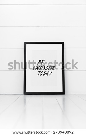 Blank frame on a white background with quotation. Be awesome today. - stock photo