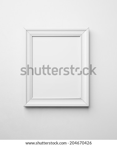 blank frame on a white wall - stock photo