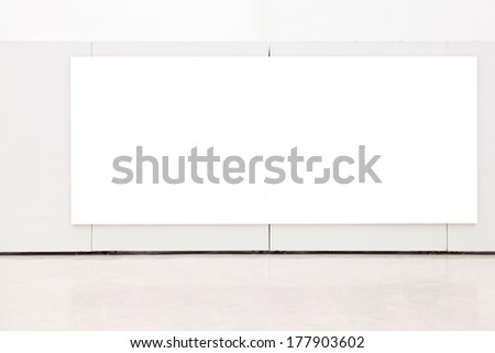 Blank frame on the wall at art museum - stock photo