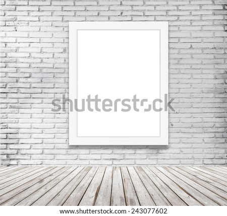 blank frame on white brick wall  - stock photo