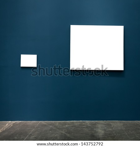 blank frames in the blue wall - stock photo