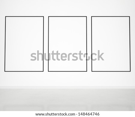 blank frames on wall - stock photo