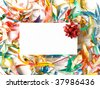 Blank gift card with red bow around colored confetti. Shallow DOF. - stock photo