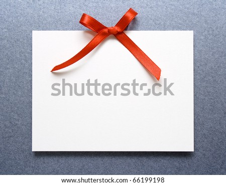 Blank gift tag with red bow - stock photo
