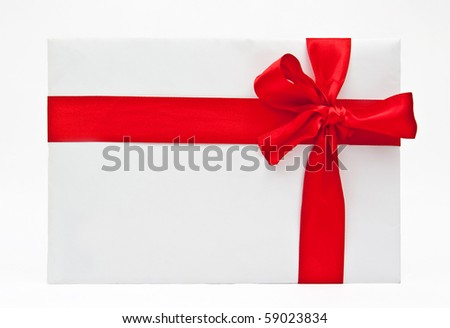 Blank gift with a bow of red satin ribbon - stock photo
