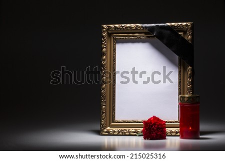 Blank gold mourning frame on the black background - stock photo