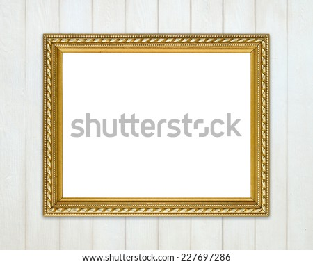 blank golden frame on wood wall background - stock photo
