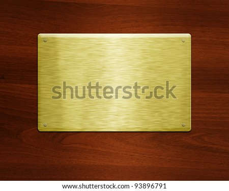 Blank golden plate at wooden background with copy space