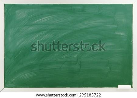 Blank green chalkboard with chalk - stock photo