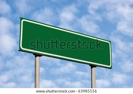 Blank Green Road Sign, Against Light Cloudscape, Summer Sky And Clouds - stock photo