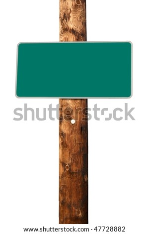 Blank green traffic sign on wooden electric pole