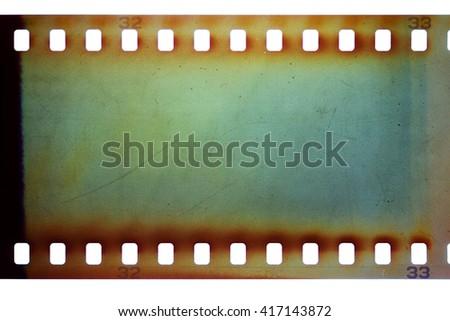 Blank green vibrant noisy film strip texture background - stock photo