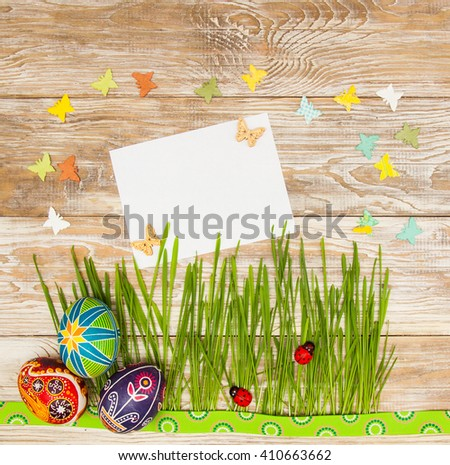 Blank, greeting easter card with easter eggs, bunny and green grass on shabby wooden background - stock photo