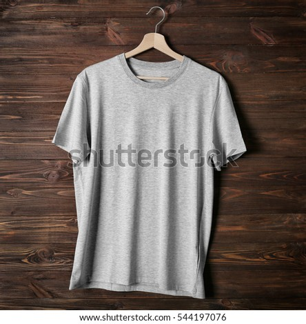 Blank grey t-shirt against wooden background