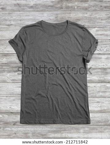 Blank grey t-shirt on wood floor - stock photo