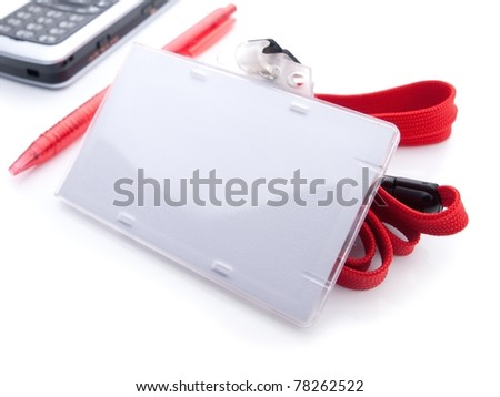 Blank ID card holder isolated on white, with red pen and cell phone.