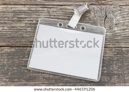 Blank ID card tag on old wooden background - stock photo