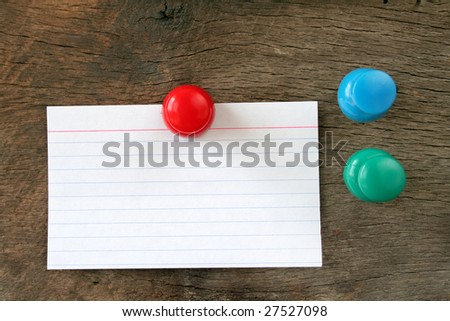 Blank index card hung on a piece of wood with a stick pin. - stock photo
