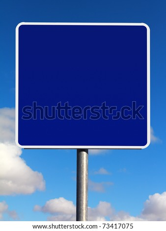 Blank informational traffic sign on a sky background - stock photo