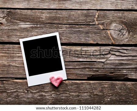 Blank instant photo and sweet red heart. On old wood background. - stock photo