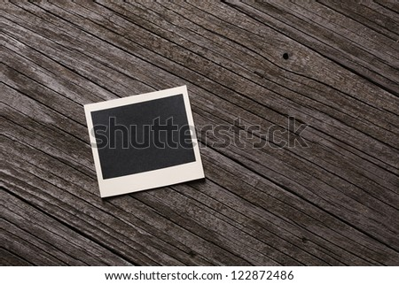 Blank instant photo on wooden background - stock photo