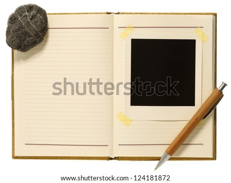 Blank instant photo, pencil and stone  in notion book - stock photo