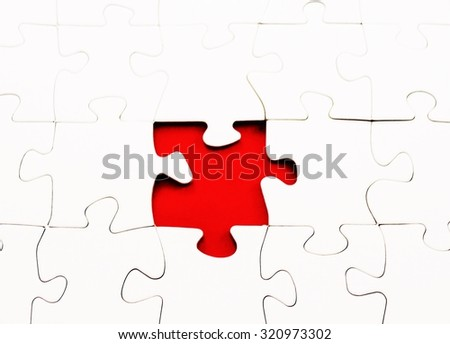 blank jigsaw puzzle red piece missing