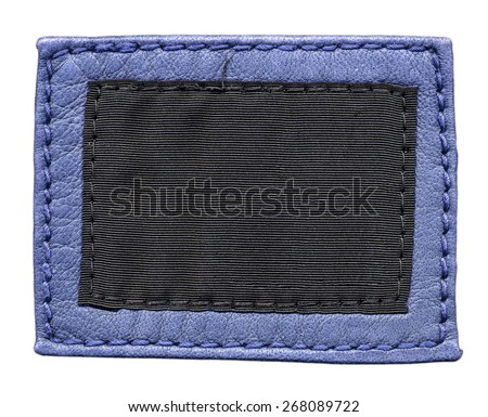blank  label of blue leather and brown textile on white background - stock photo