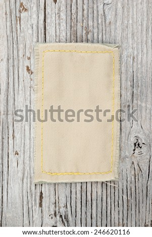 Blank label on wooden background - stock photo