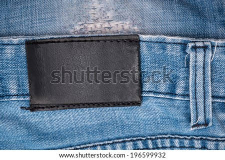 Blank leather jeans black label sewed on a blue jeans. - stock photo