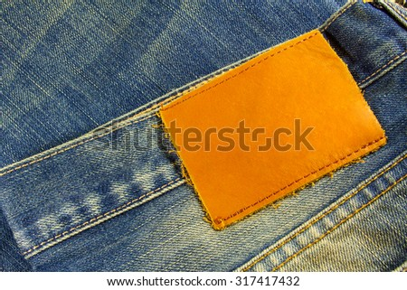 Blank leather jeans label for your text - stock photo