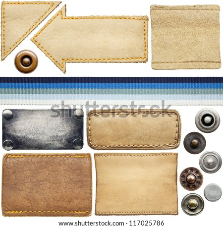 Blank leather jeans labels, buttons, rivets. - stock photo