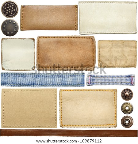 Blank leather jeans labels, buttons, straps isolated on white background - stock photo
