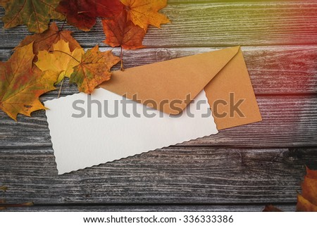 Blank letter on vintage wooden background