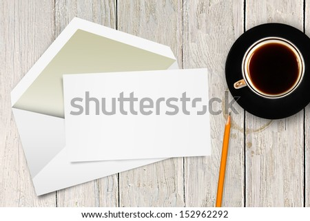 blank letter with envelope and coffee cup on the table - stock photo