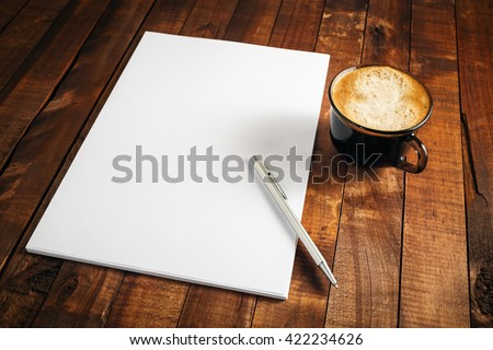 Blank letterhead, coffee cup and pen. Blank branding template. Photo of blank stationery. Mock-up for design presentations and portfolios. - stock photo