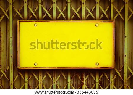 blank license plate on old steel door stretch background ,vintage tone - stock photo