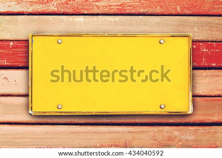 blank license plate on surface of carbon steel square tube  - stock photo