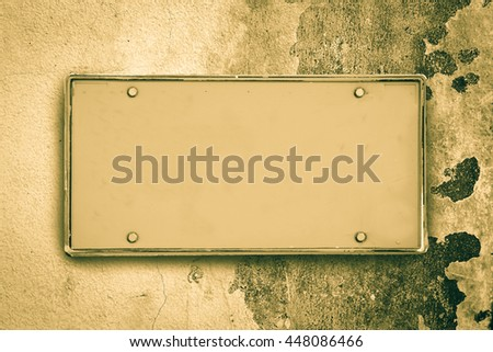 blank license plate with peel off color on the wall background - stock photo