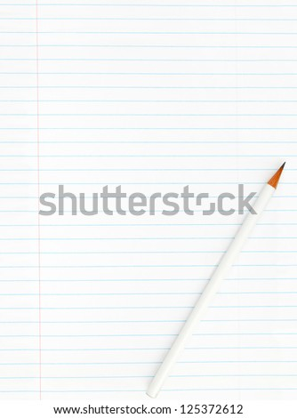 Blank lined sheet of paper from a notebook with pencil isolated on white background - stock photo