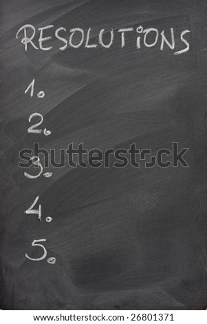 blank list of five resolutions handwritten with white chalk on a blackboard with strong eraser patterns - stock photo