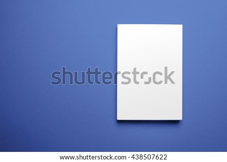Blank magazine cover template isolated on blue background with clipping path ready for your artwork - stock photo