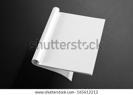 Blank Magazine on the dark Background to replace your design - stock photo